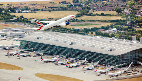 Heathrow Airport, British Airways aircraft takes off from the northern runway, Terminal 5A (centre), 26 July 2013.